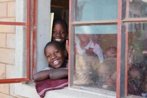 kids in dirty window